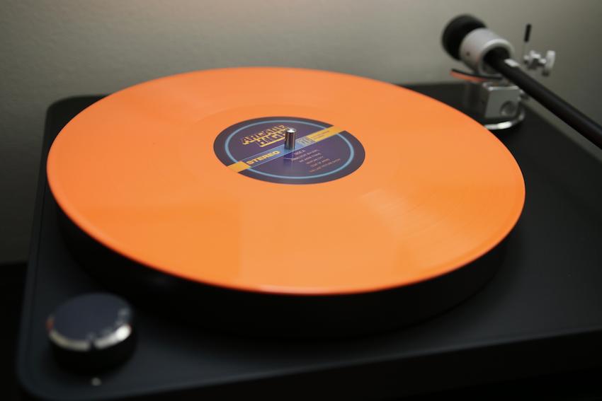 The New Impressions album by Arcade High comes in bright orange colored vinyl